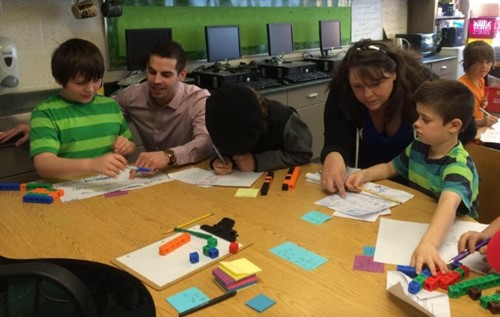 Teachers Mark Pettyjohn and Colleen Ulbrich Working with Students on Math
