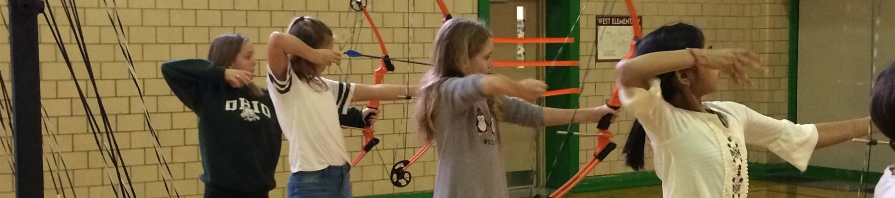 West Elementary Students - Archery in PE Class